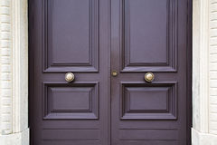 Post mail abstract brown knocker in a   closed wood door Stock Photos