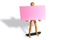 Post it man. Pink post-it attached to the on the wooden man, waiting for your message Stock Image