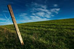 Post in a meadow. Green Royalty Free Stock Photos