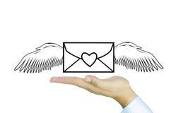 Post met engelenvleugel op Menselijke hand Stock Afbeeldingen