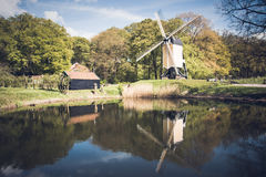 Post mill in a Dutch autumn landscape Royalty Free Stock Image