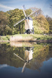 Post mill in a Dutch autumn landscape Royalty Free Stock Photo