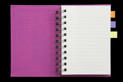 Post it on mini notebook fist page open. As black background royalty free stock photo