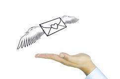 Post mit Engelsflügel auf menschlicher Hand Stockfotos