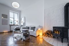 Post modern interior design. Room with fireplace