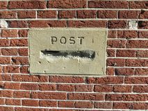 Post mortem, post box or mailbox stopped up with cement in a red brick wall stock images