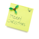Post it note. Merry christmas message on post it note isolated on white Royalty Free Stock Image