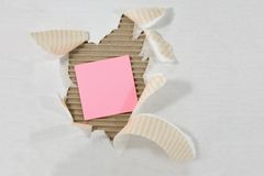 Post-It Note. Attached Torn Ripped Corrugated Cardboard Stock Photos