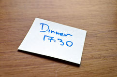 Post it note. With a dinner schedule appointment reminder Stock Photography