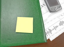 Post-it note. Yellow blank post-it note on a notebook Royalty Free Stock Images
