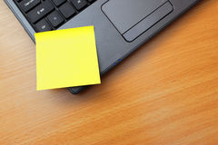 Post it note. Blank orange post it note on a laptop PC Stock Photos