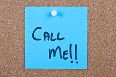 Post it note with call me. Post it note blue with call me message on cork Royalty Free Stock Photos