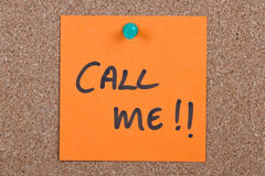 Post it note with call me. Post it note orange with call me message Royalty Free Stock Photography