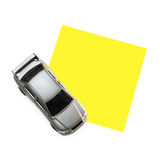 Post-It Note with Car Toy. Clean post-it note on a white background with a car toy at the left corner Stock Photography
