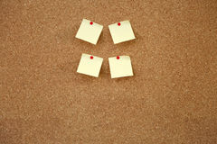 Post-it note. Colorful blank post-it note affixed to the corkboard Stock Photos