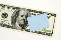 Post it note on Dollar. Concept for message notice or memo Stock Images