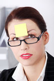 Post it note on forehead Stock Photography