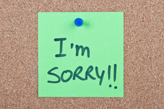 Post it note with i'm sorry. Post it note green with i'm sorry message on cork royalty free stock images