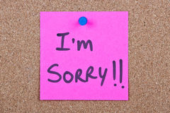 Post it note with i'm sorry. Post it note pink with i'm sorry message on cork royalty free stock photos