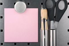 Post-it note II. Post it-notel,scissor,ball pen with Magnet on a pinboard Royalty Free Stock Photos
