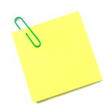Post it note isolated. Blank post it note with green paper clip isolated on white Stock Images