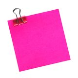 Post it note isolated. Blank pink post it note with paper clip isolated on white stock photo