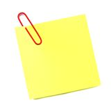 Post it note isolated. Blank post it note with red paper clip isolated on white Royalty Free Stock Photography
