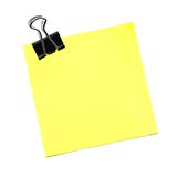 Post it note isolated. Single yellow post it note with paper clip isolated on white Stock Image