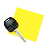 Post-It Note with Key. Clean post-it note on a white background with a car key at the left corner Royalty Free Stock Image