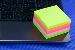 Post it note on laptop. Post it notes of different colors on laptop Stock Photo