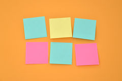 Six Sticky note on an orange wall Stock Image