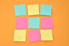 Nine sticky note on an orange wall Stock Photography