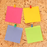 Post it note paper. Colored post-it note papers on a cork notice board stock photography