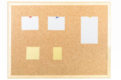 Post-it and note paper on cork board Stock Photo