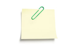 Post It Note Paper with Paperclip. On White Background Stock Photo