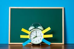 Post it note paper sticky and vintage alarm clock and blank gree. N chalkboard on table with copy space for add text notice something, list memo and schedule Stock Images