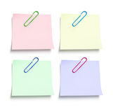 Post It Note Papers with Paperclips. On White Background Stock Image