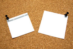 Post-it note with pushpin. White post-it note with black pushpin on corkboard Stock Images