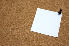 Post-it note with pushpin on corkboard Royalty Free Stock Photo