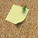 Post it note reminder on cork board. Blank post it note on cork background Royalty Free Stock Photo