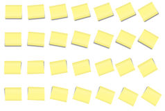POST-IT NOTE Set 2. 28 post-it notes light yellow in different angles blank with no text on it. Isolated on white background Stock Photo