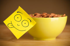 Post-it note with smiley face sticked on a bowl Royalty Free Stock Photography
