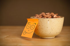 Post-it note with smiley face sticked on a bowl Stock Photos