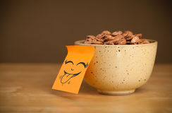 Post-it note with smiley face sticked on cereal bowl Royalty Free Stock Photos