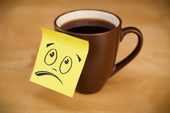 Post-it note with smiley face sticked on cup Royalty Free Stock Photography
