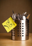 Post-it note with smiley face sticked on cutlery case Royalty Free Stock Photos