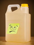 Post-it note with smiley face sticked on gallon. Drawn smiley face on a post-it note sticked on can Stock Photos