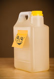 Post-it note with smiley face sticked on gallon. Drawn smiley face on a post-it note sticked on a gallon Royalty Free Stock Photos