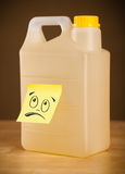 Post-it note with smiley face sticked on gallon. Drawn smiley face on a post-it note sticked on can Royalty Free Stock Photo