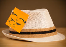 Post-it note with smiley face sticked on a hat Stock Photography